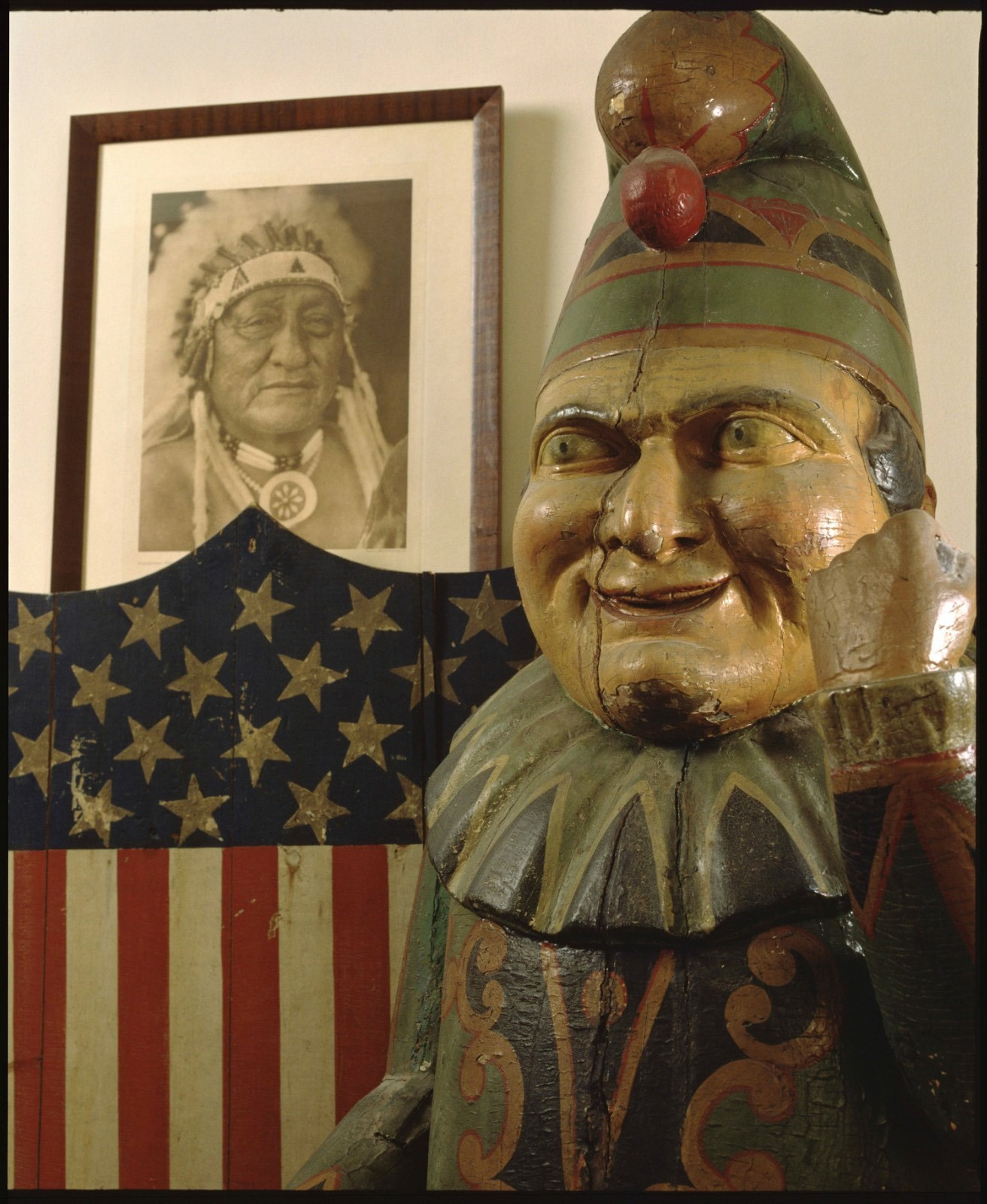 Wooden-'Punch'-with-Native-American-at-Foot-of-Sta