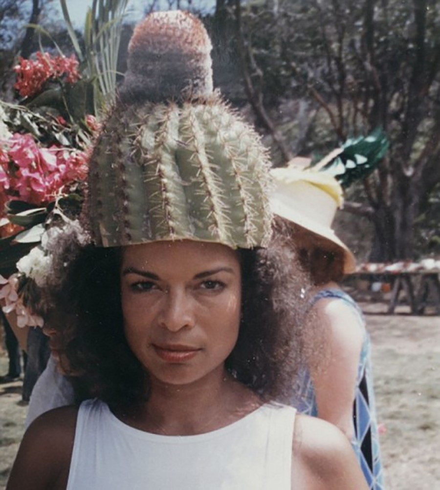 Bianca Jagger in a cactus hat on Mustique in the 70s