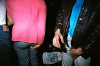 028_Two_people_touching_and_a_guy_passed_out_1977