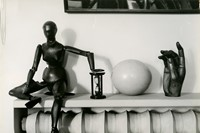Andre Kertesz, Mantlepiece with wooden figure, woo