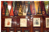 Caricatures and college shields at Harry's