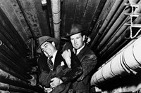 "The gang's ""muscle,"" Dix Handley (Sterling Hayden, right), h"