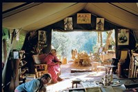 Peter Beard at work on a diary, the Beards's bedroom tent, H