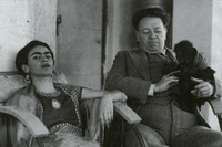 Frida Kahlo and Diego Rivera with one of their pet monkeys