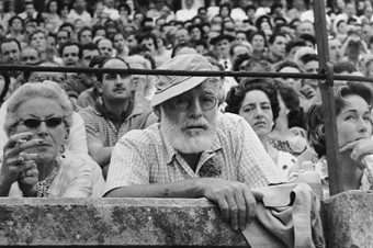 Hemingway watches the running of the bulls at Pamplona in 19
