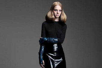 Maddy wears wool sweater and patent leather skirt by Marc Ja