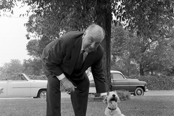 Hitchcock and one of his dogs,  August 1956