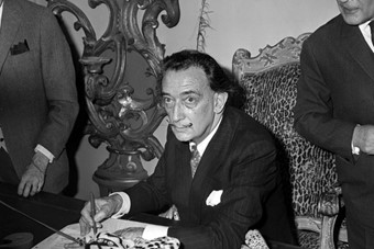 Dalí signs his book 'Lettre ouverte a Savador Dali' at his p