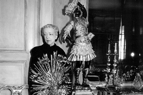 Elsie de Wolfe in her Paris apartment wearing a Schiaparelli