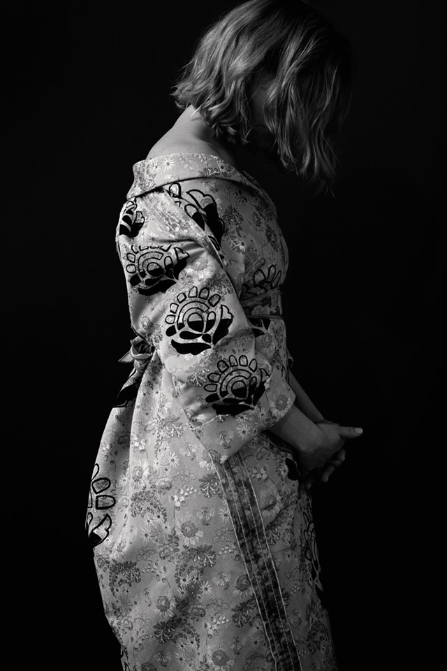 Léa wears embroidered silk jacquard coat by Prada; silk scar
