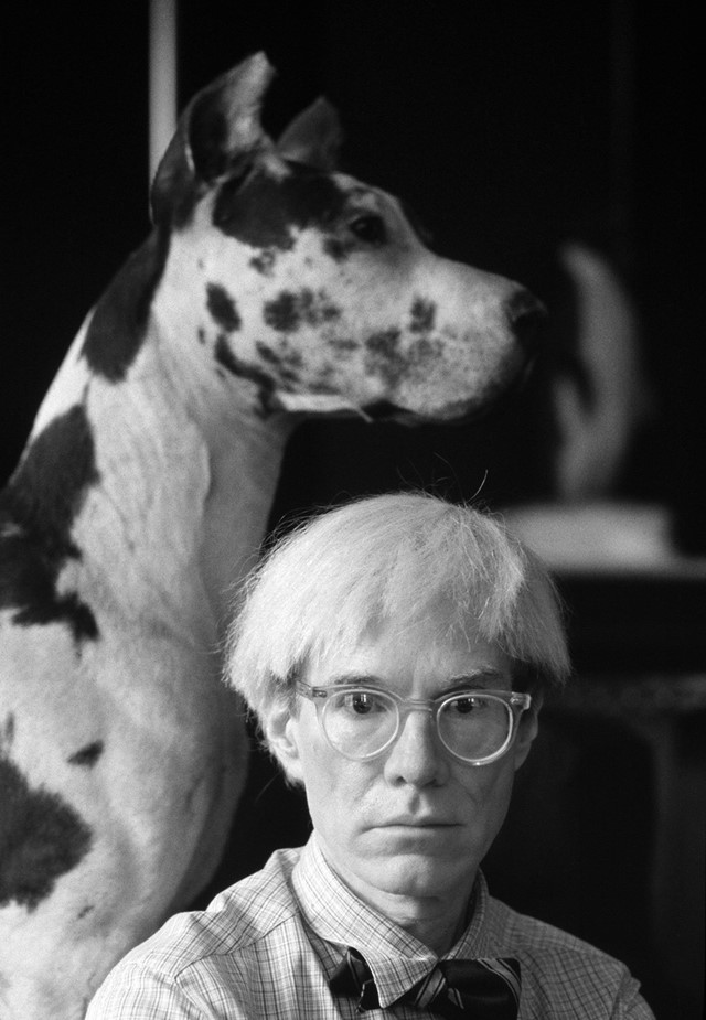 Andy Warhol and his dog at the Factory in New York