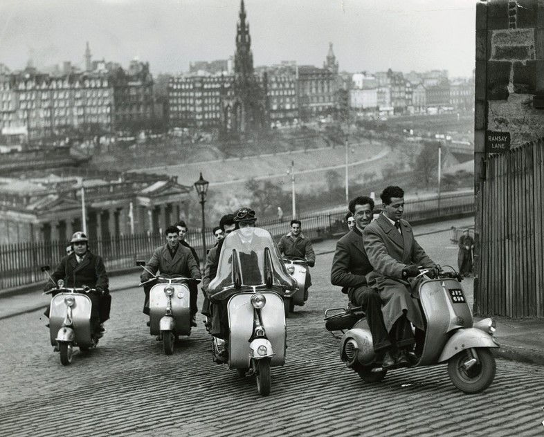 Vespas climbing the mound, 1954