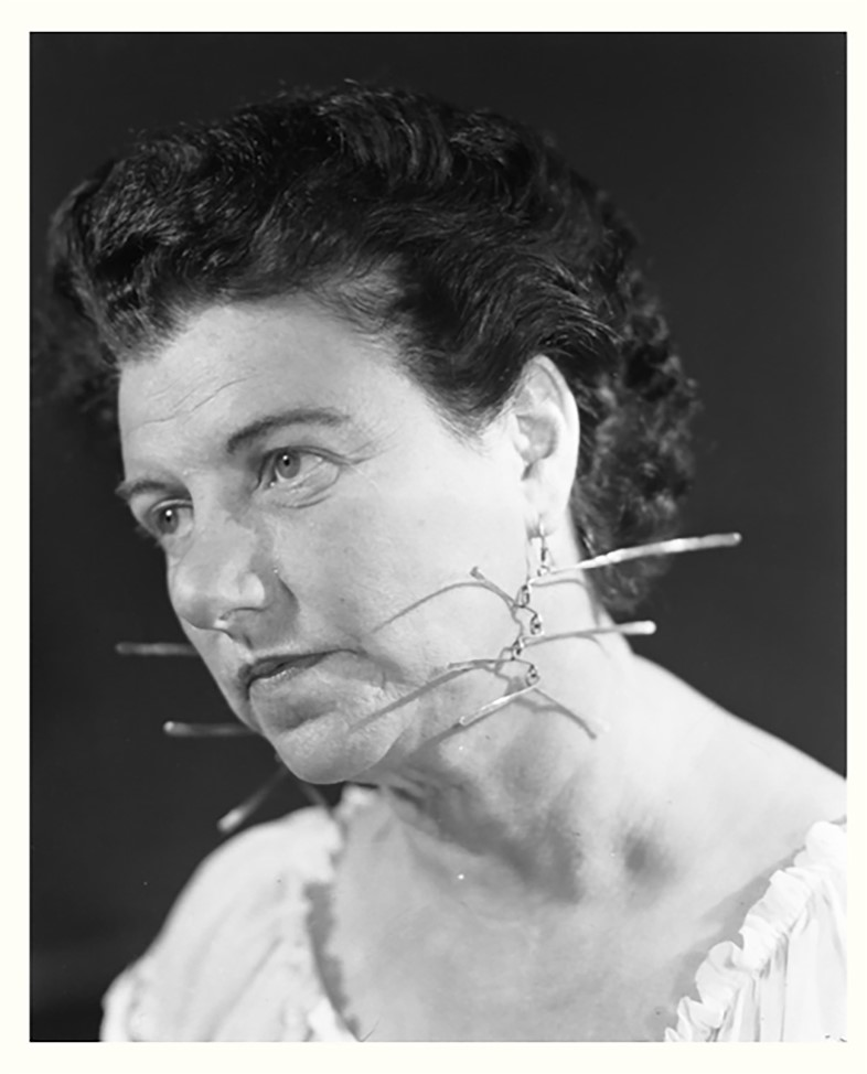 Peggy Guggenheim wearing earrings by Alexander Cal