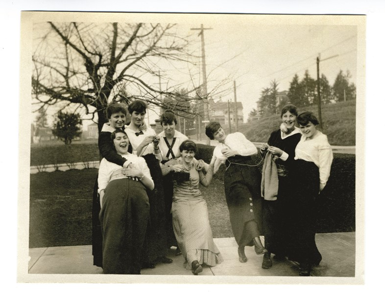 Photograph of women, most likely in a knitting circle, ca. 1