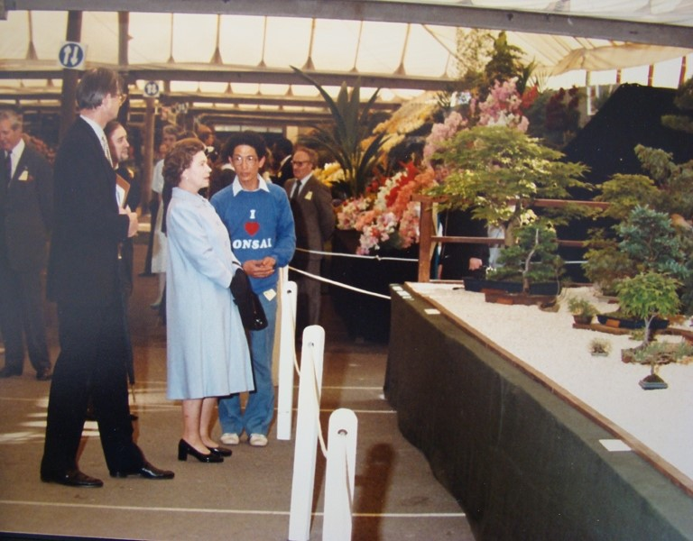 Peter Chan with the Queen, 1984
