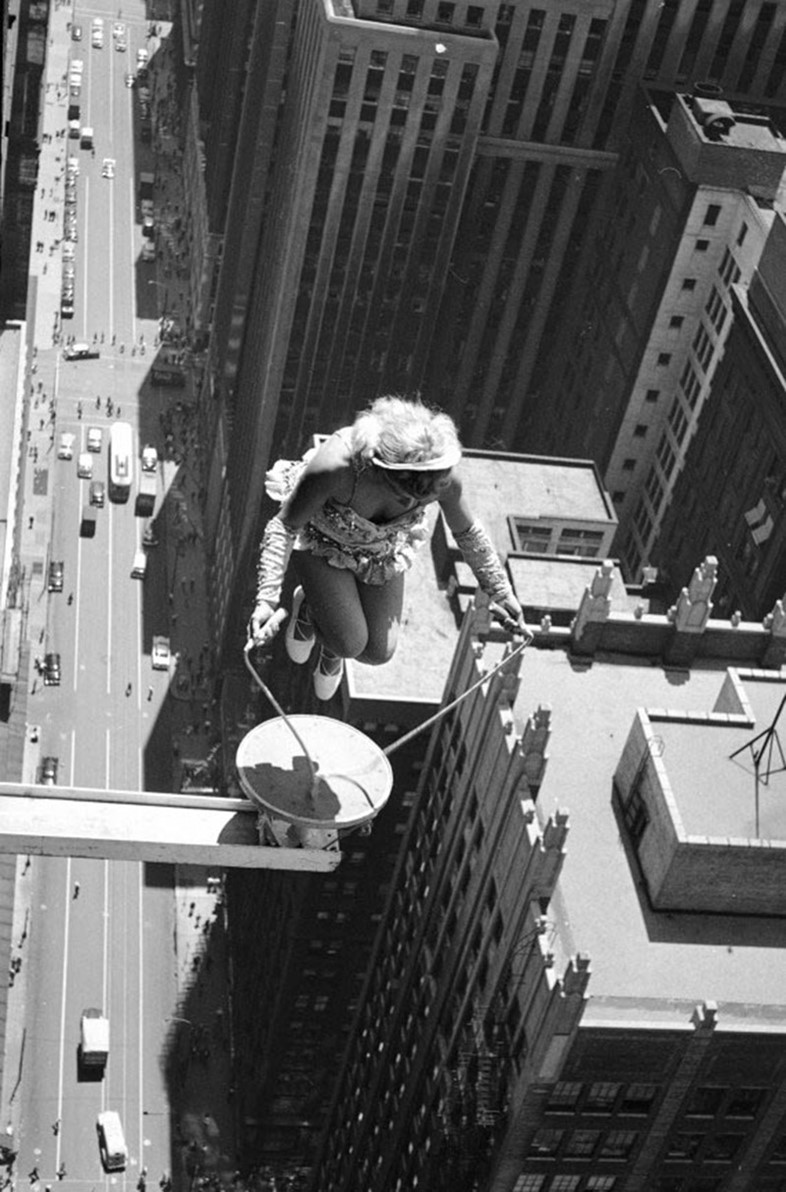 A female performer skips rope above Chicago in 1955