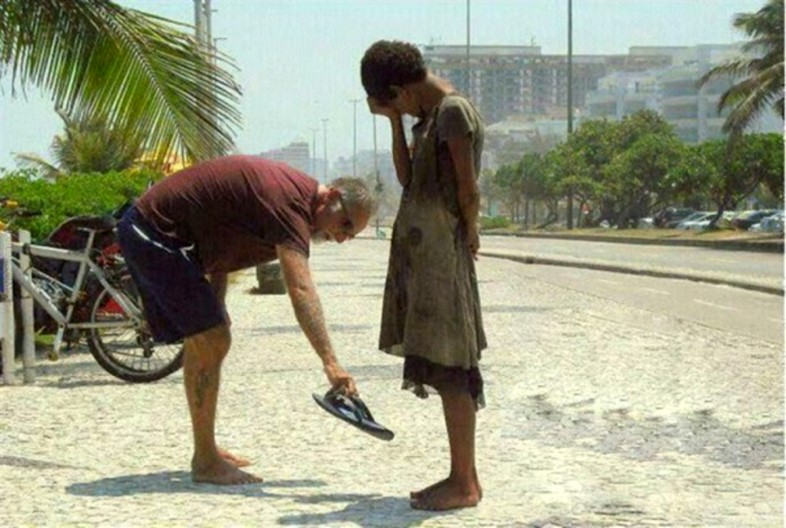 A man gives away his shoes