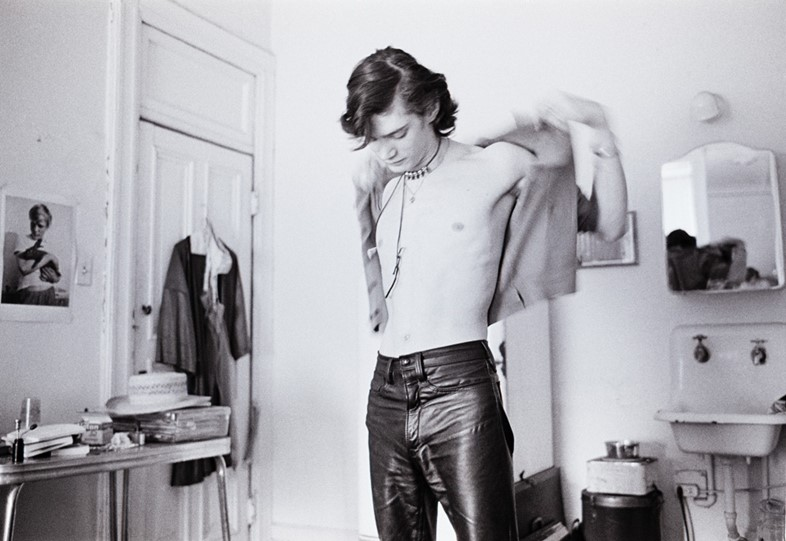 Robert Mapplethorpe gets dressed at the Chelsea Hotel