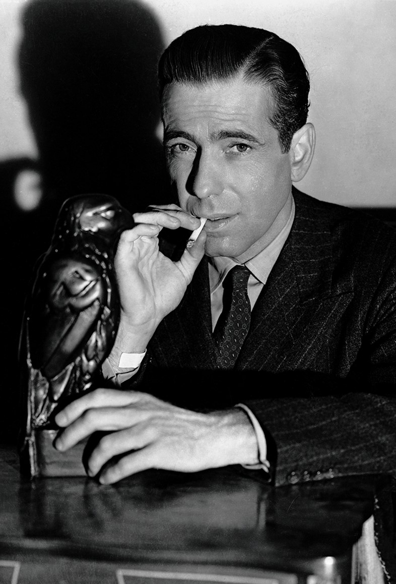 Sam Spade (Humphrey Bogart) is embroiled in the hunt for a m