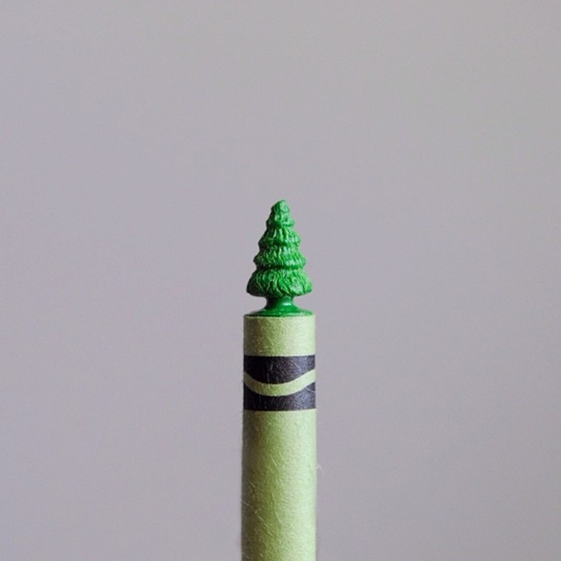 Green crayon tree carved with a sewing needle