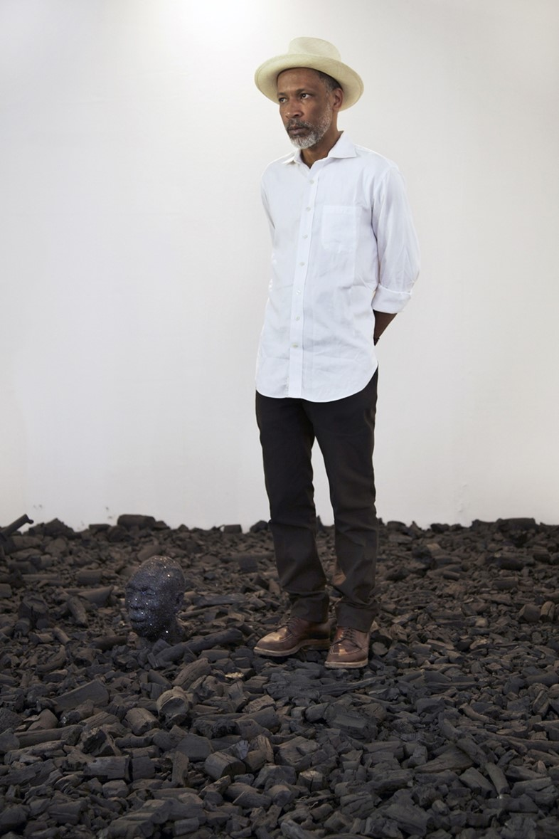 Radcliffe Bailey standing in his piece entitled Storm at Sea