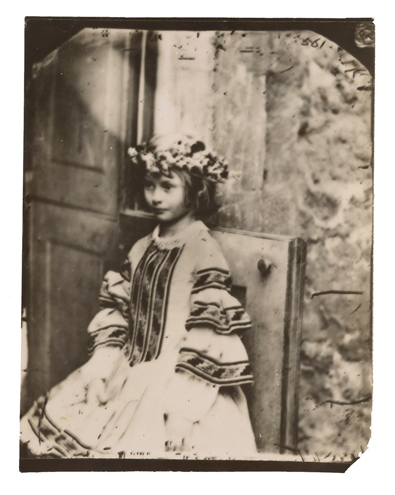 "Alice Liddell in wreath as ""Queen of May,"""