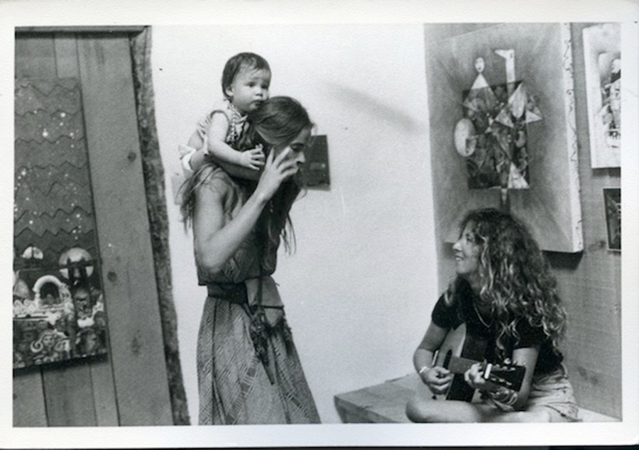 Untitled (woman with baby on shoulders)