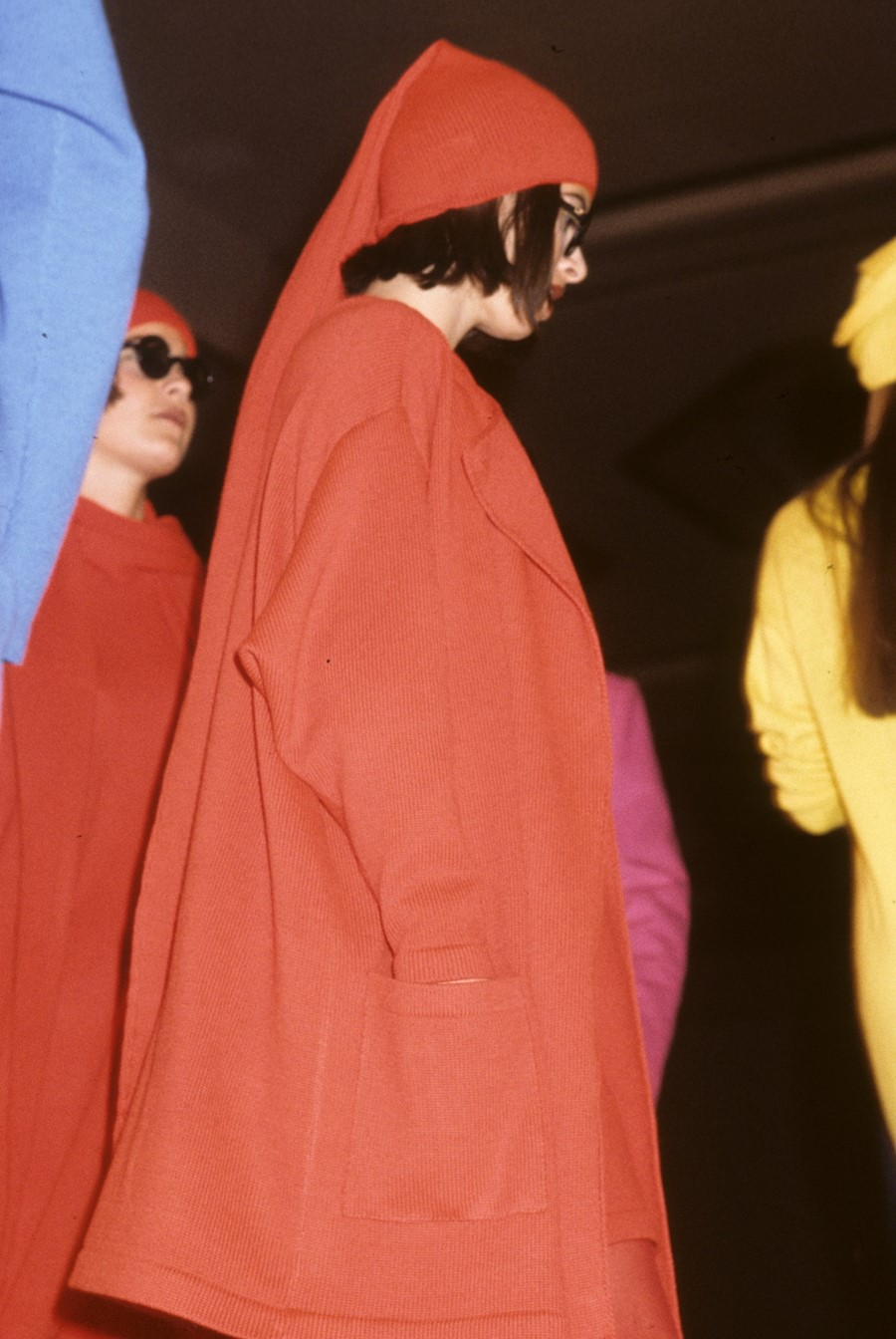 1984. Stephen Sprouse. Model wearing a red coat an